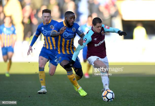Abumere Ogogo of Shrewsbury Town and Javier Hernandez of West Ham United battle for the ball during The Emirates FA Cup Third Round match between...