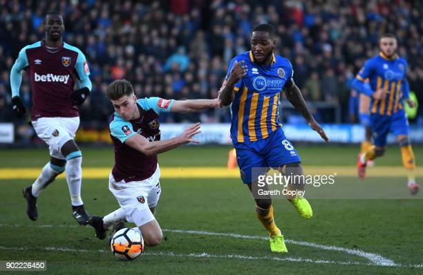 Abumere Ogogo of Shrewsbury Town goes past Reece Burke of West Ham United during The Emirates FA Cup Third Round match between Shrewsbury Town and...