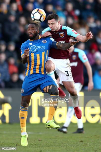 Abumere Ogogo of Shrewsbury Town jumps for a header with Josh Cullen of West Ham United during The Emirates FA Cup Third Round match between...