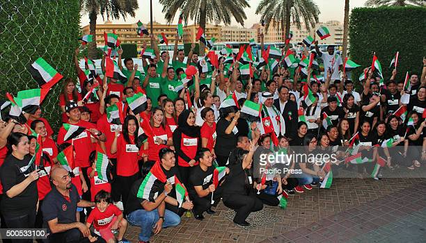 Abunader's Group of Company staffs celebrating the 44th UAE National Day at Philippine Supermarket