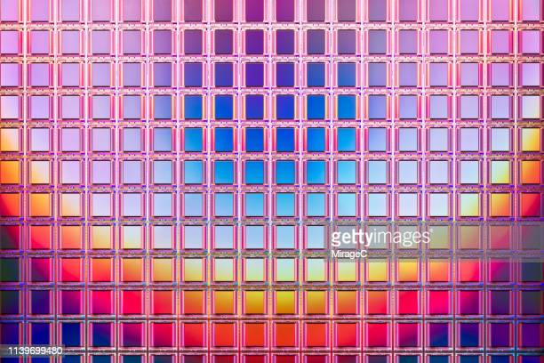 abundance of camera cmos on silicon wafer - sensor stock pictures, royalty-free photos & images