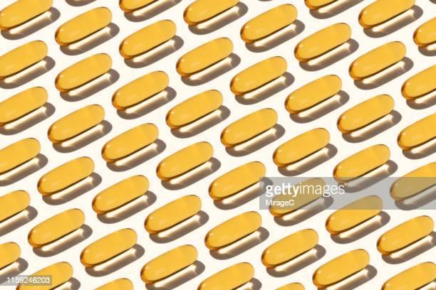 abundance of fish oil soft capsules - ビタミン類 ストックフォトと画像