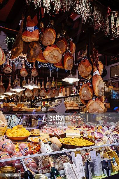 abundance of food at deli in market - bologna stock pictures, royalty-free photos & images