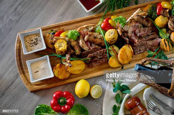 abundance of meat - spanish food stock photos and pictures
