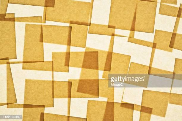 abundance of messy paper backlit - quadrato composizione foto e immagini stock