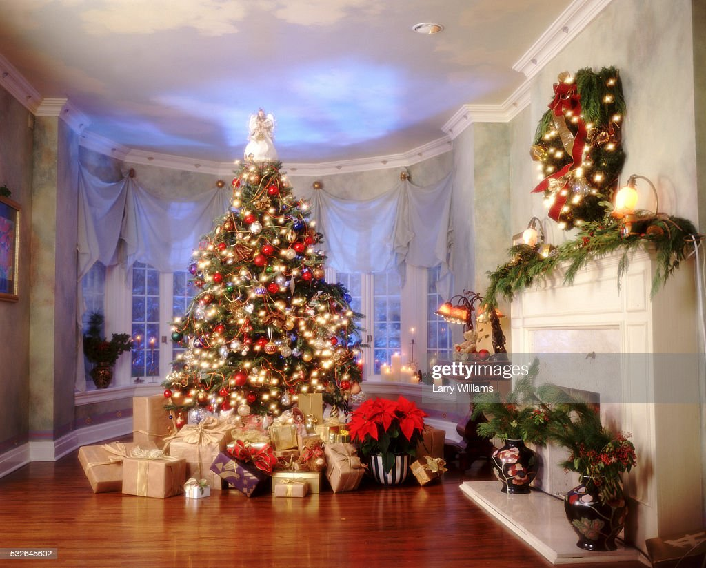 abundance of presents under christmas tree stock photo