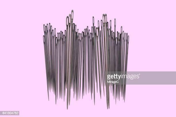 abundance of sewing needles - sewing needle stock pictures, royalty-free photos & images