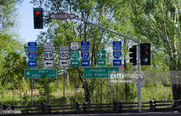 abundant highway signs - flagstaff arizona stock pictures, royalty-free photos & images