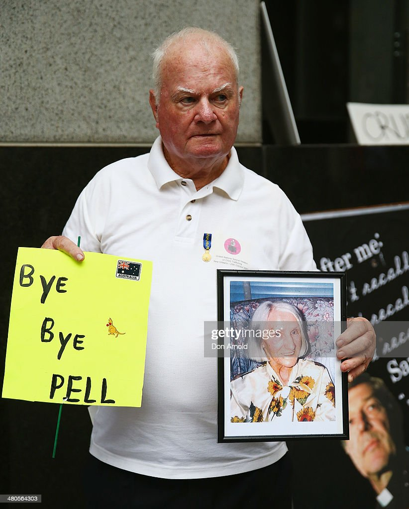 Abuse survivor John Hennessy protests outside Phillip Macquarie Tower on March 24, 2014 in Sydney, Australia. Cardinal Pell is facing the Royal Commission into Institutional Responses to Child Sexual Abuse in Sydney to answer questions about whether he was involved in compensation discussions related to the case of John Ellis who was sexually abused by Father Aidan Duggan.Cardinal Pell will soon move to Rome to undertake a senior role at the Vatican.