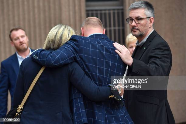 Abuse victims of former football coach Barry Bennell emrbace after speaking to the media outside Liverpool Crown Court on February 19 2018 after the...