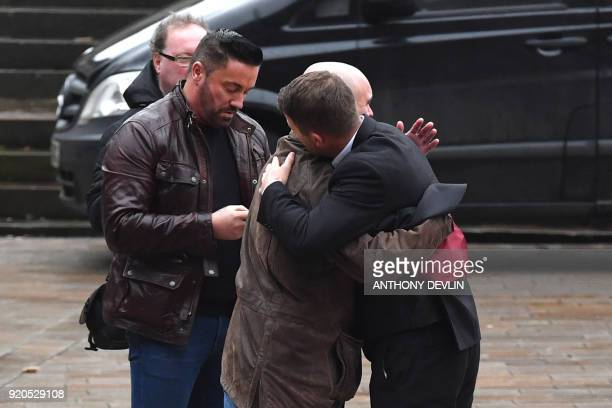 Abuse victims of former football coach Barry Bennell Steve Walters greets a supporter as he arrives at Liverpool Crown Court on February 19 2018 for...