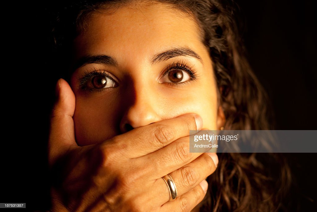 Abused Woman being silenced : Stock Photo