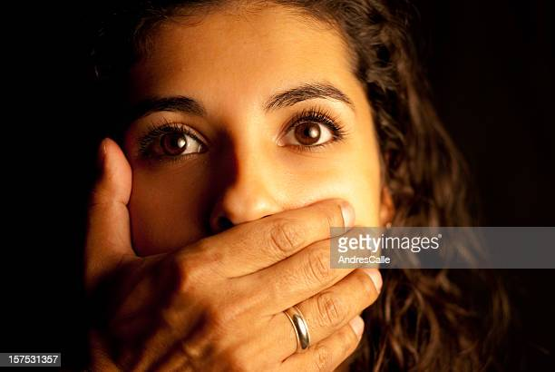 abused woman being silenced - married stock photos and pictures