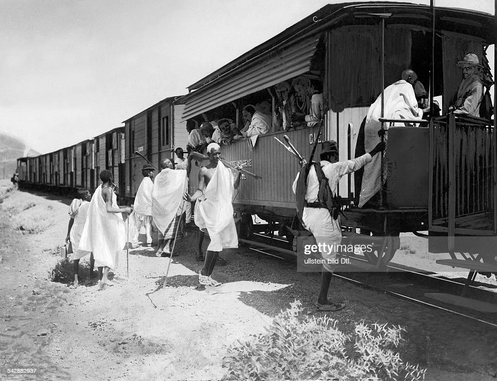 Abyssinia, native people ascending the train, first railway