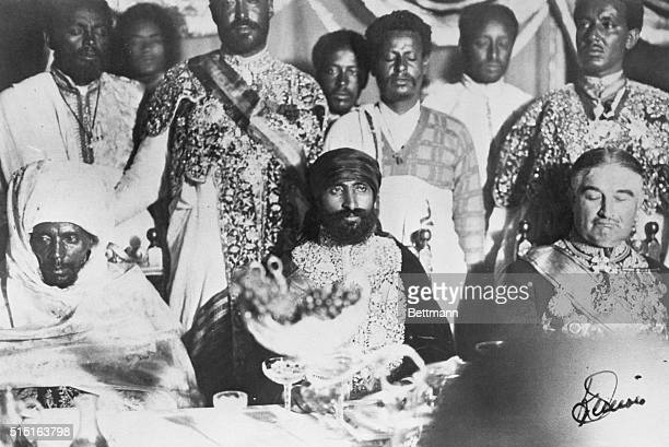 Photo shows a close up of King Ras Tafari of Abyssinia seated at the reception table after his coronation which took place recently He shares the...