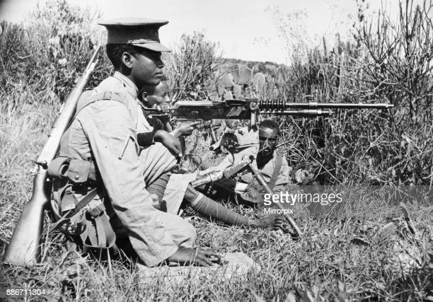 Abyssinian War September 1935 Abyssinian machine gunner firing an old Hotchkiss machine gun on the Ogadan front during the Italian invasion of...