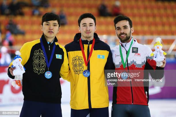 Abzal Azhgaliyev Denis Nikisha of Kazakhstan and Francois Hamelin of Canada pose in the Men's 500m medal ceremony during day two of the ISU World Cup...