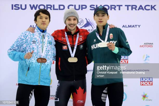 Abzal Azhgaliyev of Kazakhstan poses during the medal ceremony after winning the 3rd place Samuel Girard of Canada 1stock and Shaong Liu of Hungary...