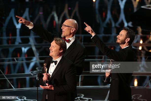 ONLY_HOLLYWOOD aäCA aê February 22 2015 Winners for Best Animated Feature Film 'Big Hero 6' Don Hall Chris Williams and Roy Conli accept their...