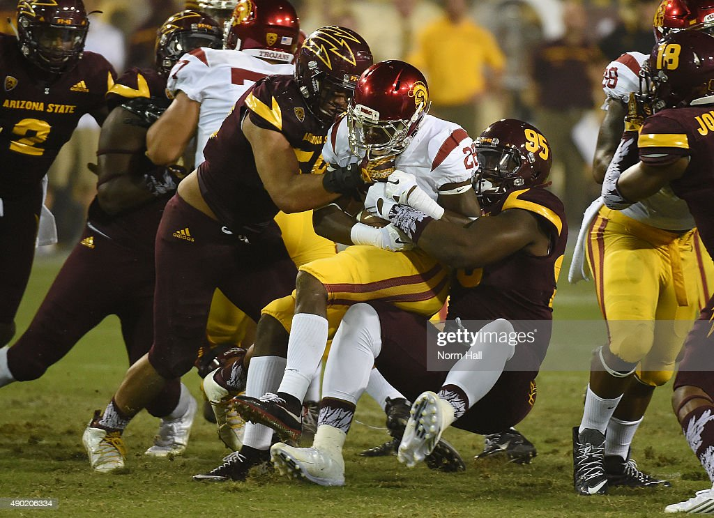 Aca'Cedric Ware #28 of the Southern California Trojans is tackled by Salamo Fiso #58 and Renell Wren #95 of the Arizona State University Sun Devils during the second half at Sun Devil Stadium on September 26, 2015 in Tempe, Arizona. Trojans won 42-14.