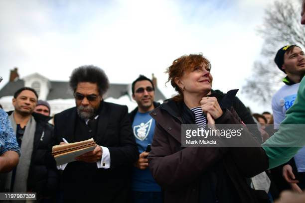 Academic Cornel West and actress Susan Sarandon supporters of Democratic Presidential candidate Bernie Sanders depart after speaking at an event with...