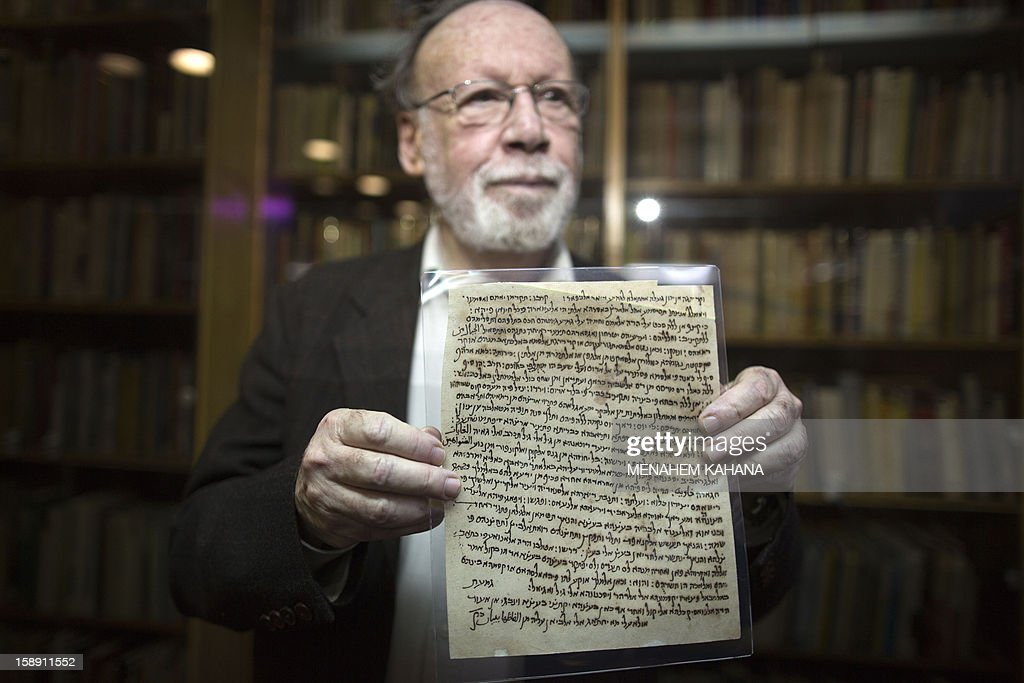 Academic director of the National Library of Israel professor Haggai Ben-Shammai displays a document from a collection of discarded religious Jewish writings, discovered inside caves in a Taliban stronghold in northern Afghanistan, which date back from the 10th century during a press conference on January 3, 2013, at the national library in Jerusalem. The national library recently acquired 29 items from the collection, or Genizah, which contains the first-ever documentation of the religious, cultural and commercial life of the Jewish community in that era and area.