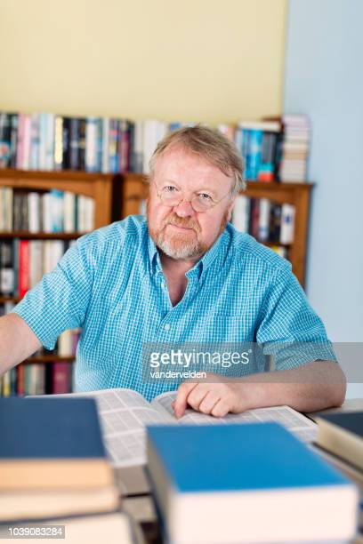academic in his library - short sleeved stock photos and pictures