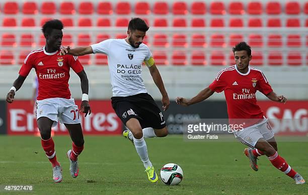 Academica de Viseu's midfielder Tome with SL Benfica II's forwards Sancidino Silva and Joao Carvalho in action during the Primeira Liga match between...