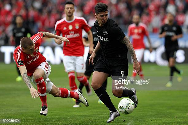 Academica's Portuguese forward Rabiola in action with Benfica's Swedish defender Victor Lindelöf during the Premier League match between Academica...