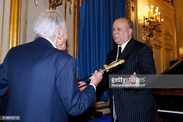 Academician Jean d'Ormesson gives the Academician Sword to Marc Lambron Marc Lambron receives 'L'Epee d'Academicien' of 'Academie Francaise' on April...