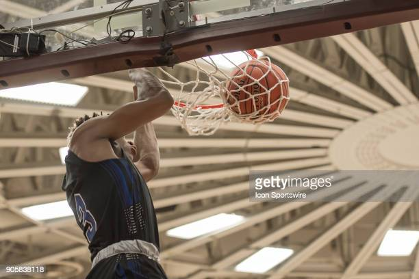 Academy Ascenders guard Jahmius Ramsey dunks during the first half of the Spalding Hoophall Classic high school basketball game between the Westtown...