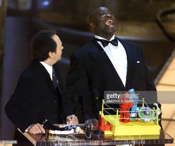 Academy Award ceremonies Host Billy Crystal and actor Michael Clarke Duncan present the Animated Action Short Film Oscar during the 72nd Academy...
