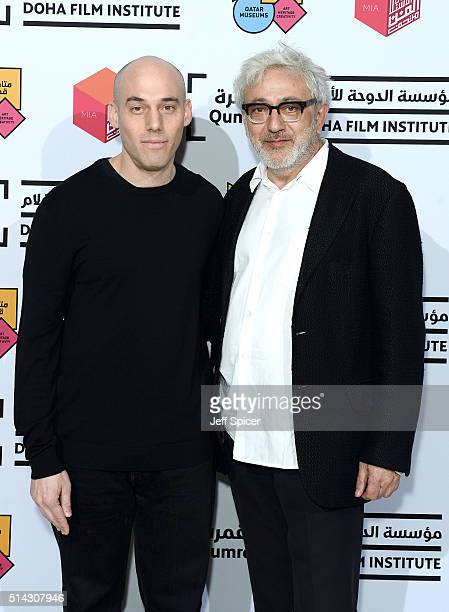 Academy Award nominated filmmaker Joshua Oppenheimer and Doha Film Institute Artistic Advisor Elia Suleiman attend a screening of 'The Look of...