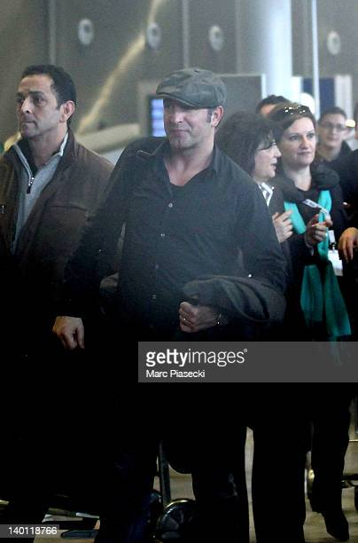 Academy Award Winner Jean Dujardin is sighted at Aeroport Roissy - Charles de Gaulle on February 28, 2012 in Paris, France.