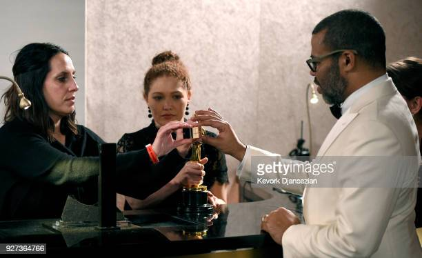 Academy Award winner Jordan Peele at engraving station with award for Best Original Screenplay for 'Get Out' at the 90th Annual Academy Awards...