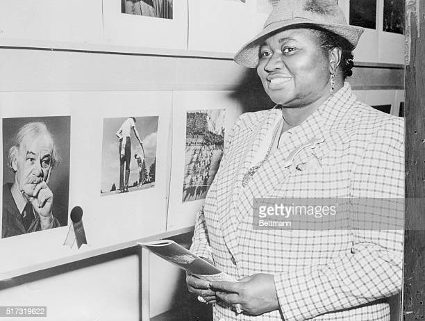 Academy Award Winner Views Camera Exhibit New York New York Here on her honeymoon Hattie McDaniel in private life now Mrs Donald Crawford views the...