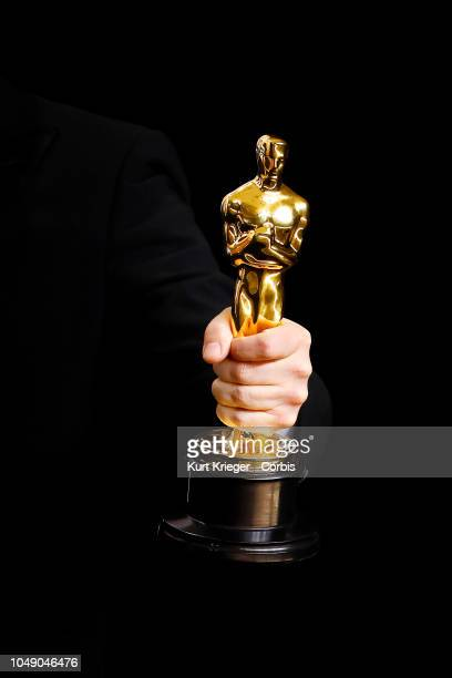 Academy Award winner´s hand holding an Oscar statue in the press room during the 90th Annual Academy Awards at Hollywood Highland Center on March 4...