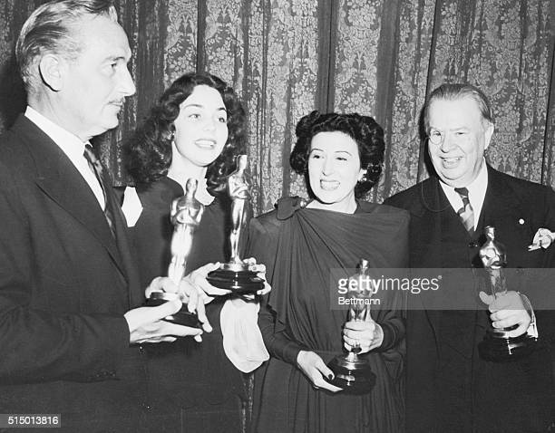 Academy Award winners holding their statues from left Paul Lukas for Watch on the Rhine Jennifer Jones Song of Bernadette Katina Paxinou for For Whom...