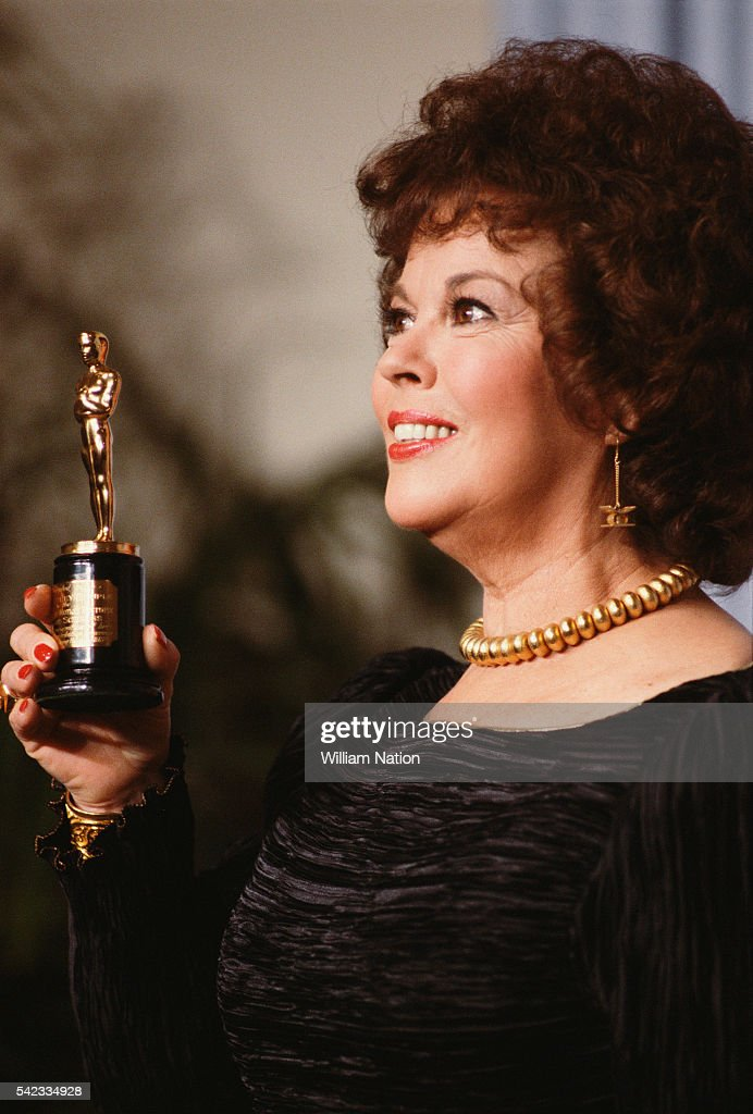 Academy Award winning actress, tap dancer, and iconic American child actress of the 1930s Shirley Temple holds her 1935 Academy Award, the miniature statuette Juvenile Award, at the 56th Academay Awards.