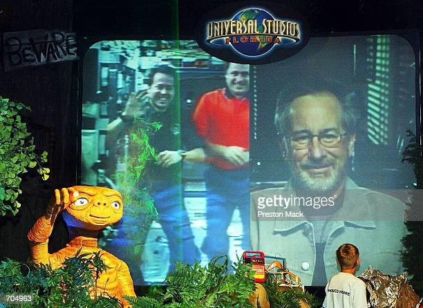 Academy Award winning director Steven Spielberg speaks with astronauts Daniel Bursch and Yuri Ivanovich Onufrienko aboard the International Space...