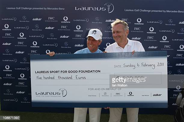 Academy Member Gary Player with Dr Joachim Schmidt and a big cheque after the Laureus Golf Challenge at the Saadiyat Beach Golf Club part of the 2011...