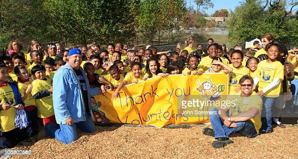Academy of Country Music Award winners Eddie Montgomery and Troy Gentry poses for a photo with kids from Booker T Washington Academy after they...