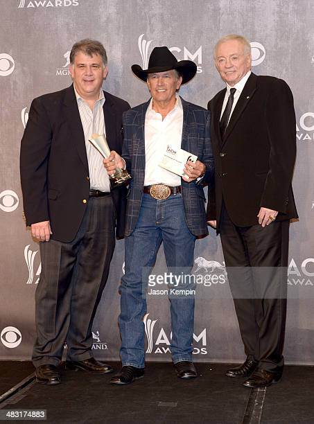 Academy of Country Music CEO Bob Romeo recording artist George Strait and Owner President and General Manager of the Dallas Cowboys Jerry Jones pose...
