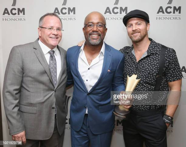 Academy of Country Music CEO Pete Fisher honoree Darius Rucker and Kip Moore take photos during the 12th Annual ACM Honors at Ryman Auditorium on...