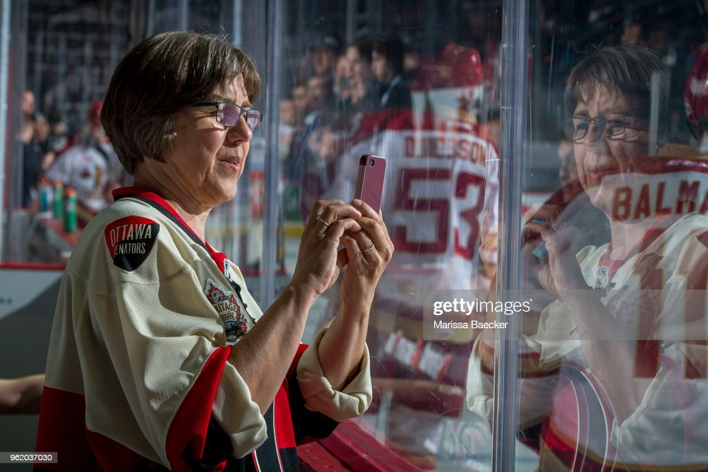 A Acadie-Bathurst Titan fan takes photos through the glass during warm up against the Hamilton Bulldogs at Brandt Centre - Evraz Place on May 22, 2018 in Regina, Canada.