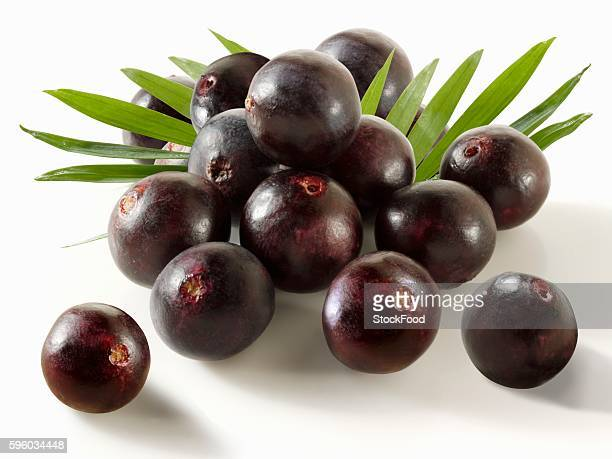 acai berries with leaves - acai stock pictures, royalty-free photos & images