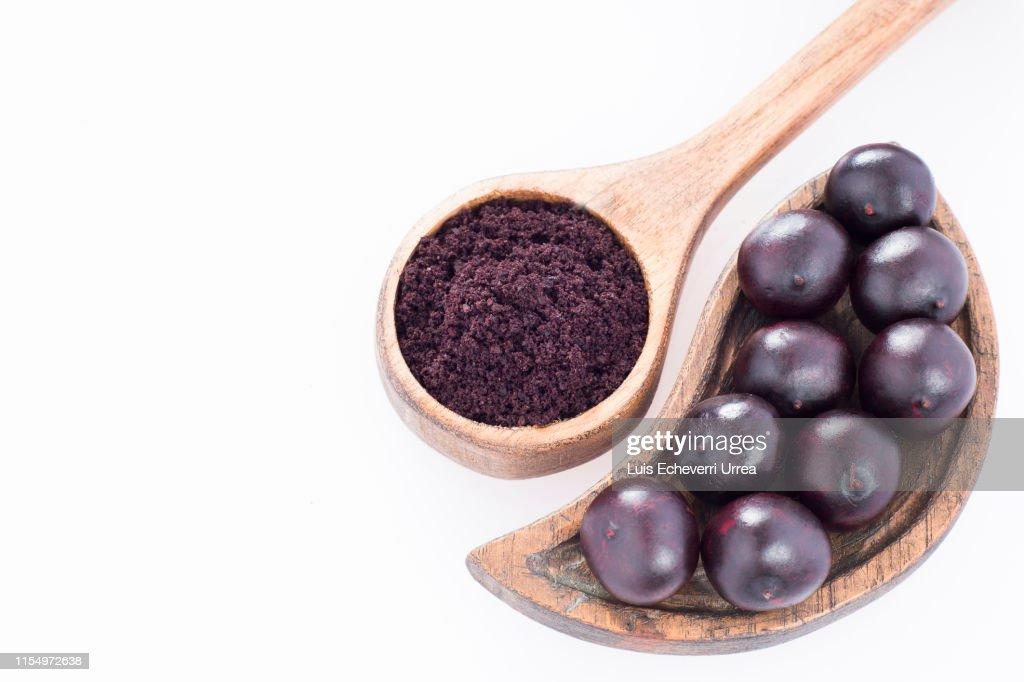 Acai powder and berries - Euterpe oleracea : Stock Photo