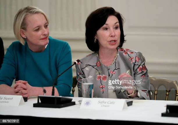 Accenture CEO Julie Sweet and Oracle CoCEO Safra Catz participate in a meeting of the White House American Technology Council in the State Dining...