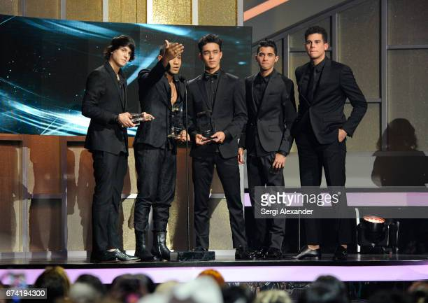 CNCO accept an award onstage at the Billboard Latin Music Awards at Watsco Center on April 27 2017 in Coral Gables Florida
