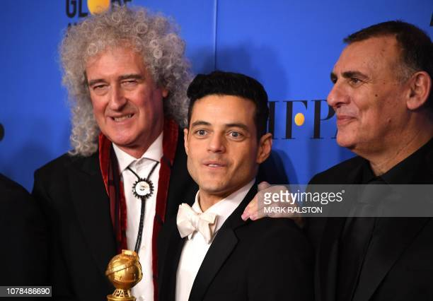Accepting the trophy for Best Motion Picture Drama for Bohemian Rhapsody Graham King Brian May pose with Best Actor in a Motion Picture Drama winner...